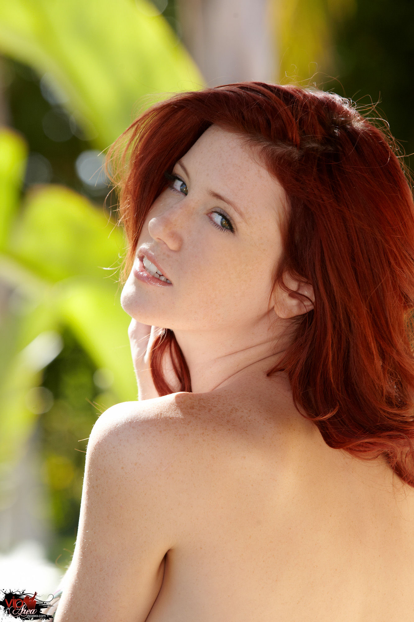 Bare legged redhead Elle Alexandra uncovers her flat chest while undressing  229146