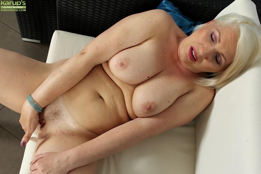 Blonde mature woman masturbating