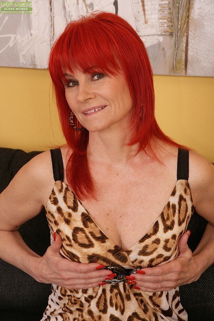 Busty mature redhead Mae Victoria spreading and fondling hairy cunt  886748