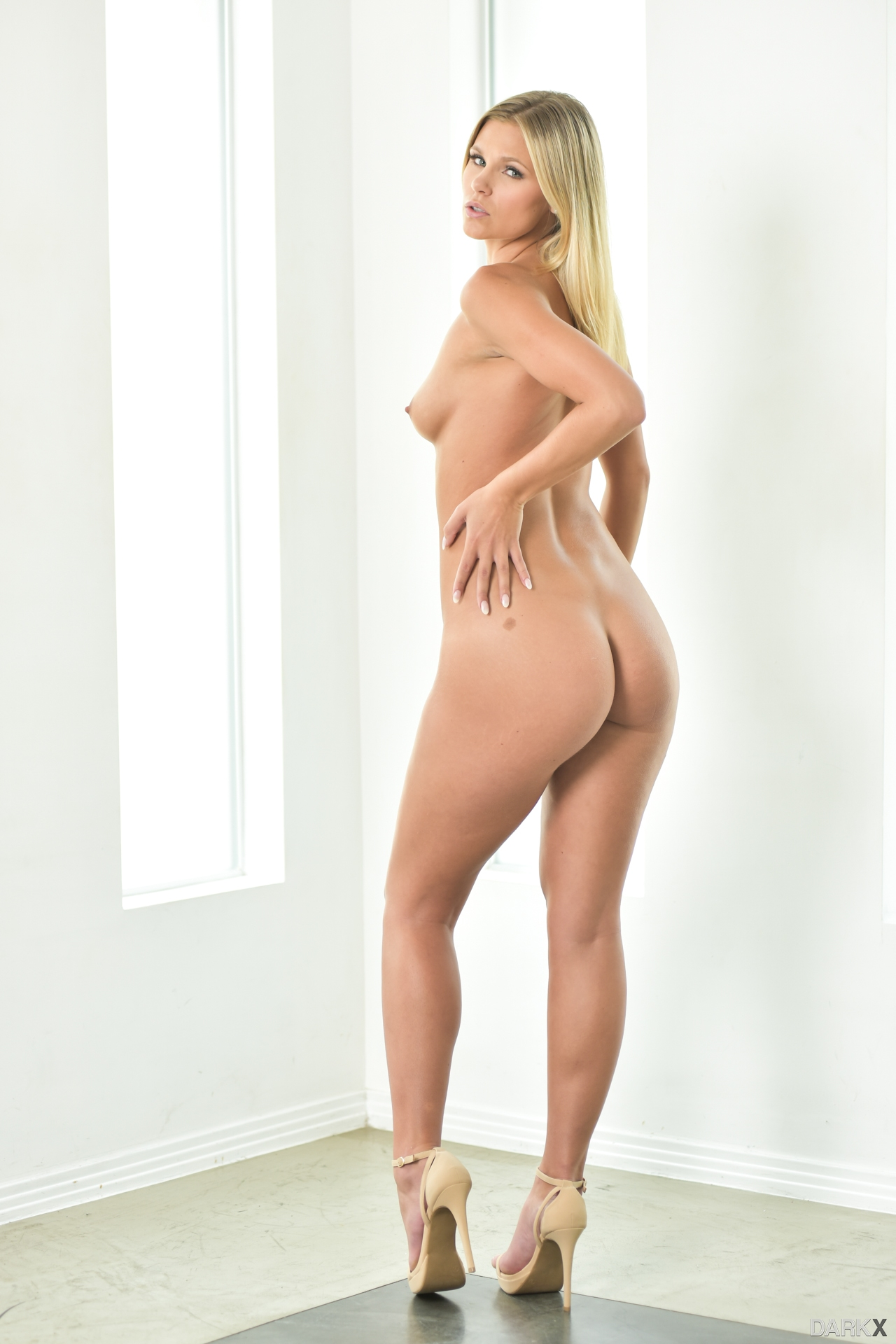 Adorable tall amateur blonde poses nude