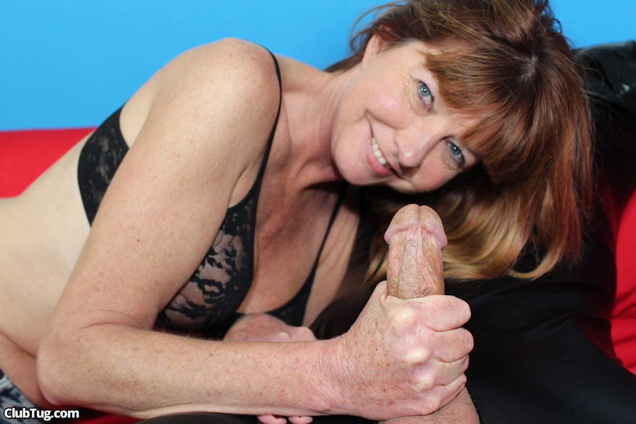 Naughty mature woman giving a handjob