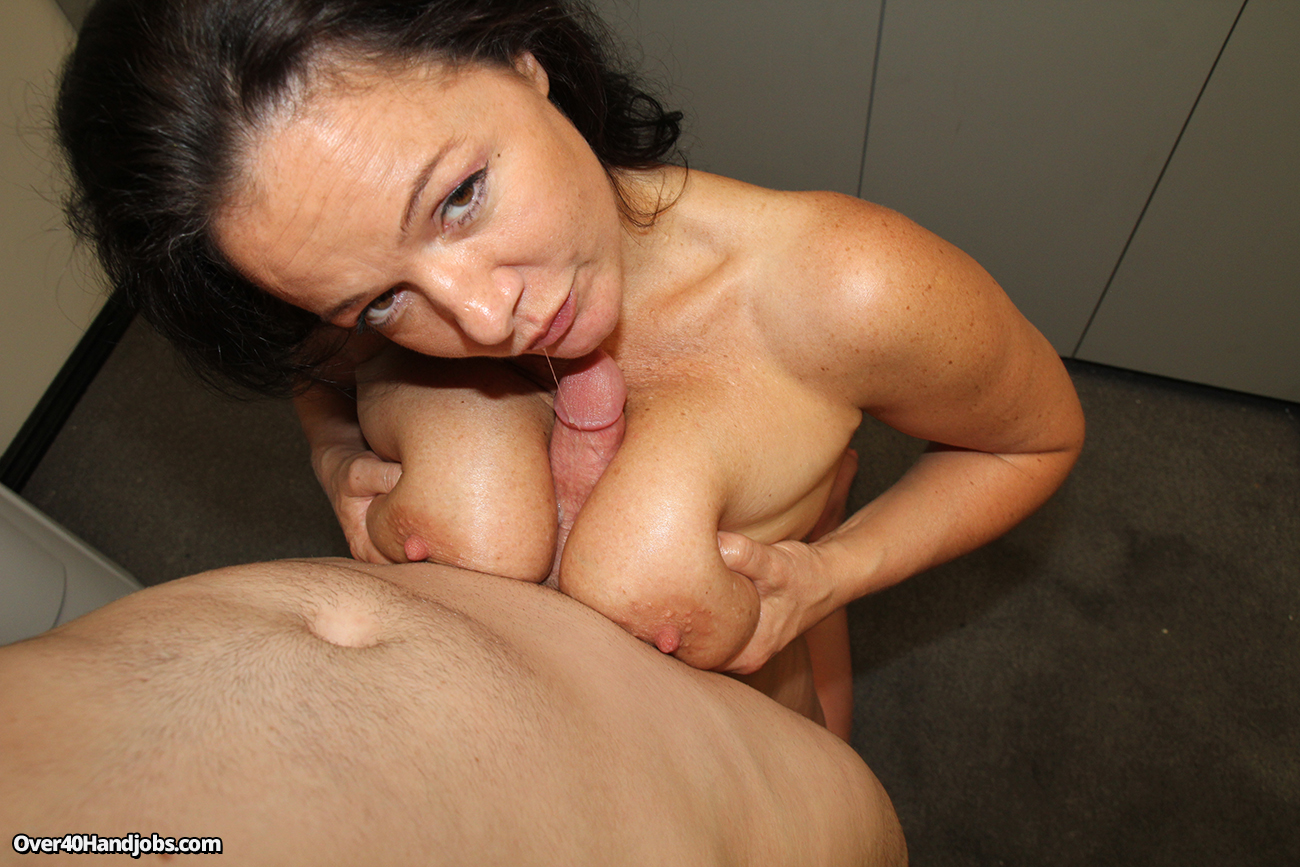 Exciting tittyfucking in a role of a mature housewife with silicon boobs