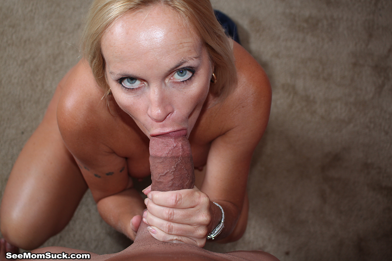 Busty milf sucking cock porn pic