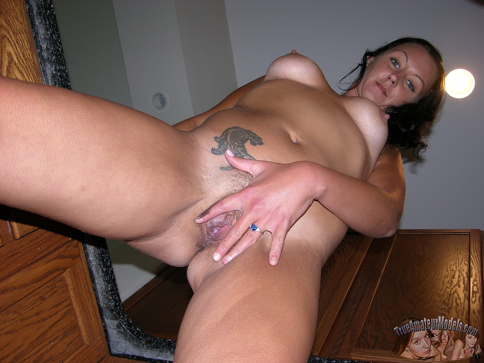 mature amateur strips and spreads pussy