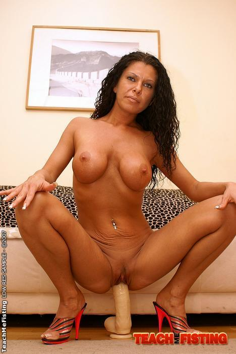Milf with big ass riding white dildo