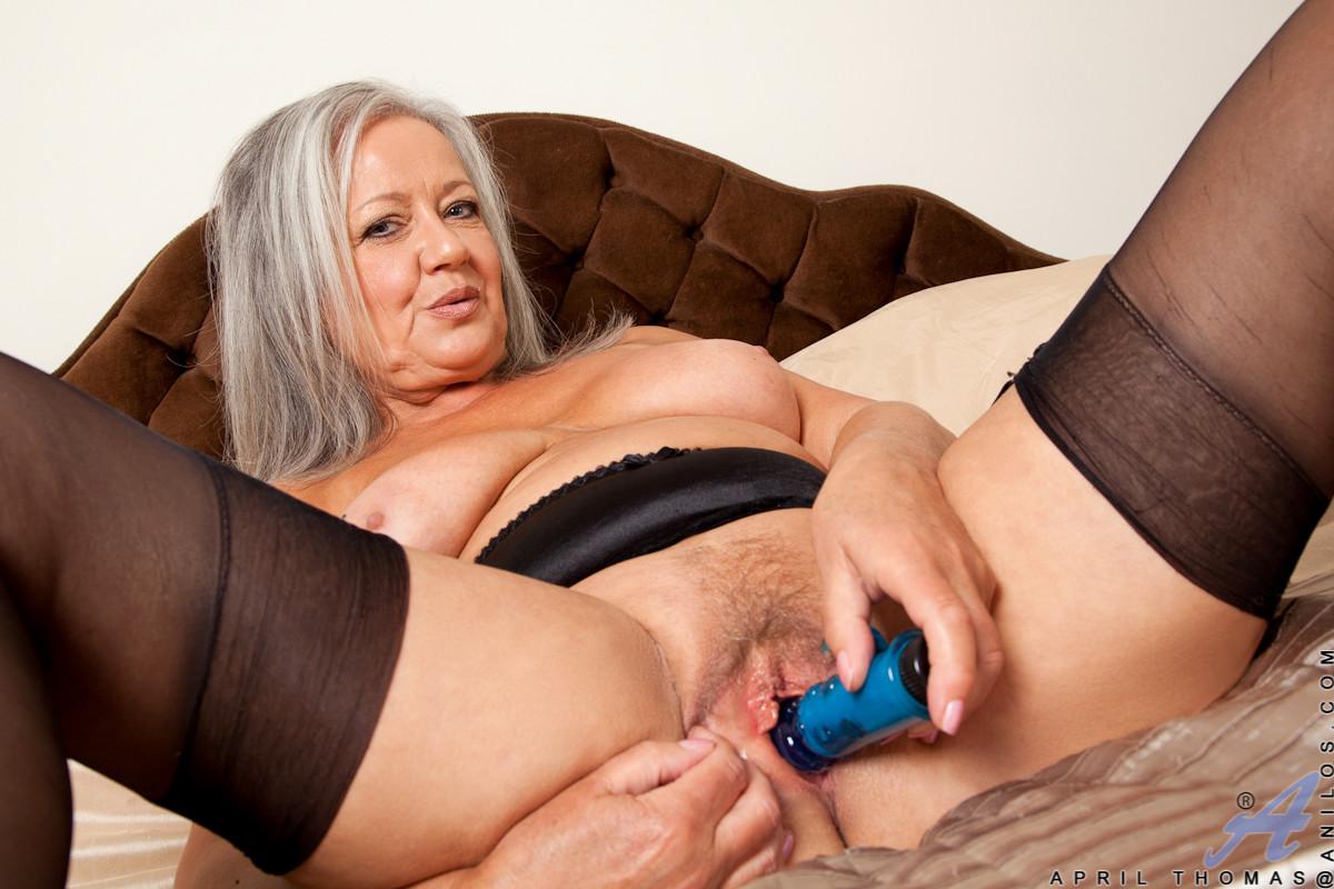 Mature grandma playing with a purple dildo
