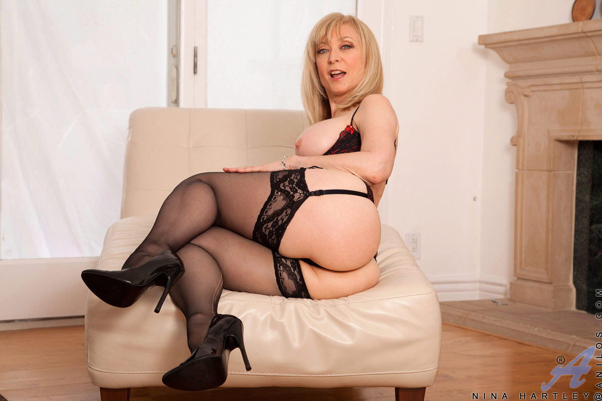 Classic Porn Star Nina Hartley playing with a Dildo