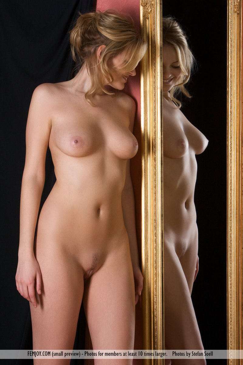 Naked women by the mirror