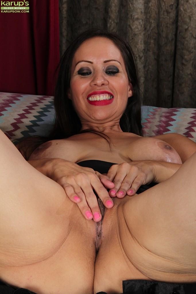 Brunette milf carmen jones with big tits presents hairy pussy