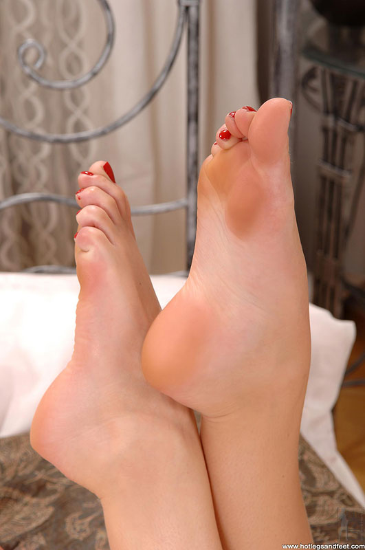 Tender foot fetish performer Judy Smile caresses her beautiful legs  1434757