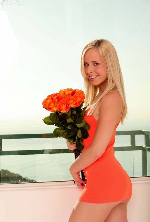 Classy flirt Kara naughtily lifts her tight, orange dress