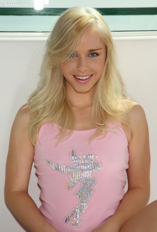 Bewitching Kara in her sexy, pink top and panties flirting