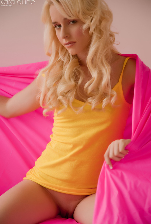 Kara Duhe in yellow tops and pink shawl spreading