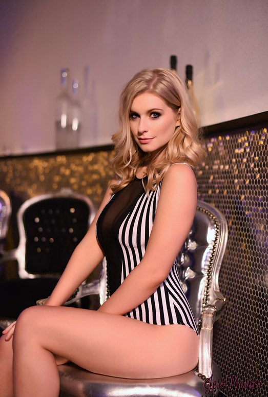 Jess Davies teases in her black and white striped body suit
