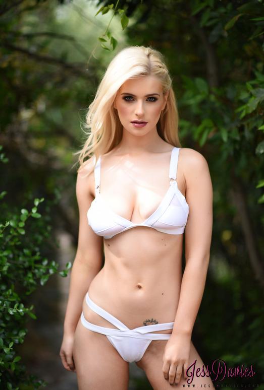 Jess Davies teasing in the garden in white lingerie