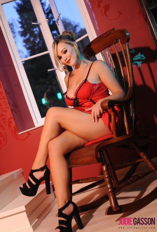 Jodie Gasson strips from her red dress and black heels