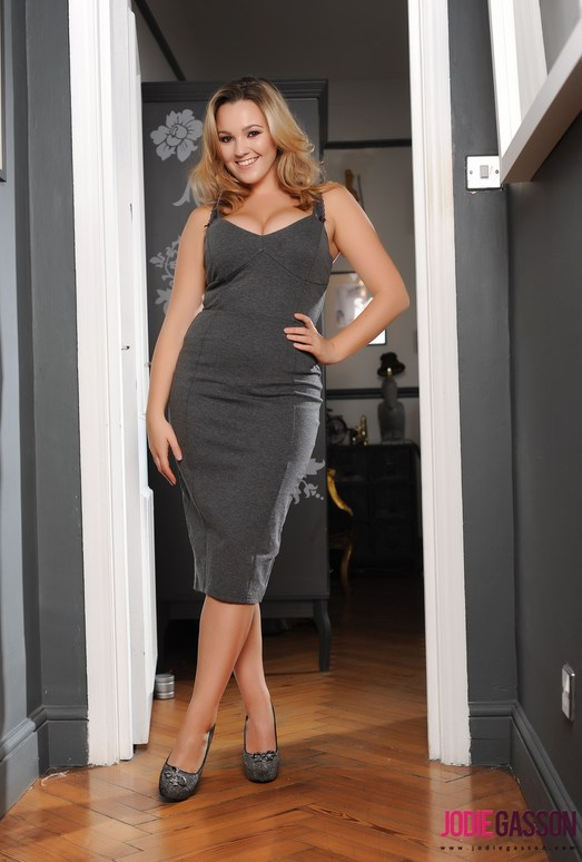 Jodie Gasson teasing in her long grey dress in the doorway