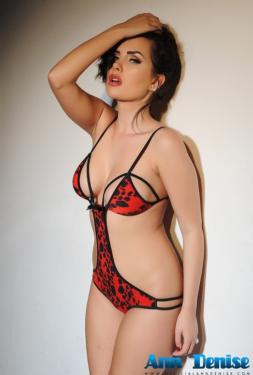 Ann Denise teasing in a skimpy black and red 1 piece
