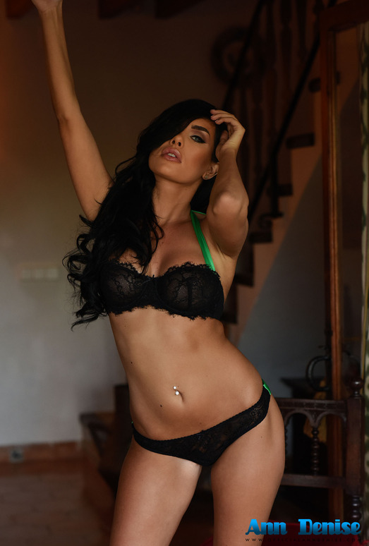 Ann Denise teasing in the doorway in black lingerie