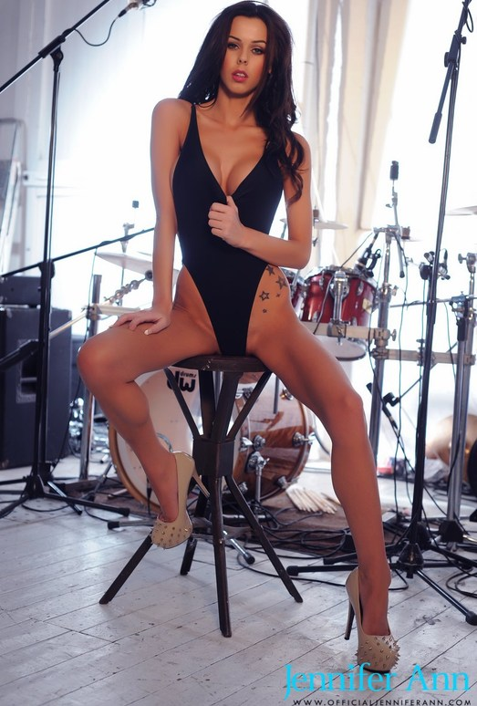 Jennifer in black bodysuit by the drums