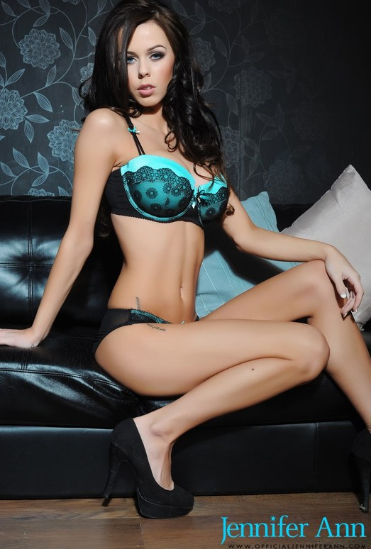 Jennifer Ann teasing on the black sofa