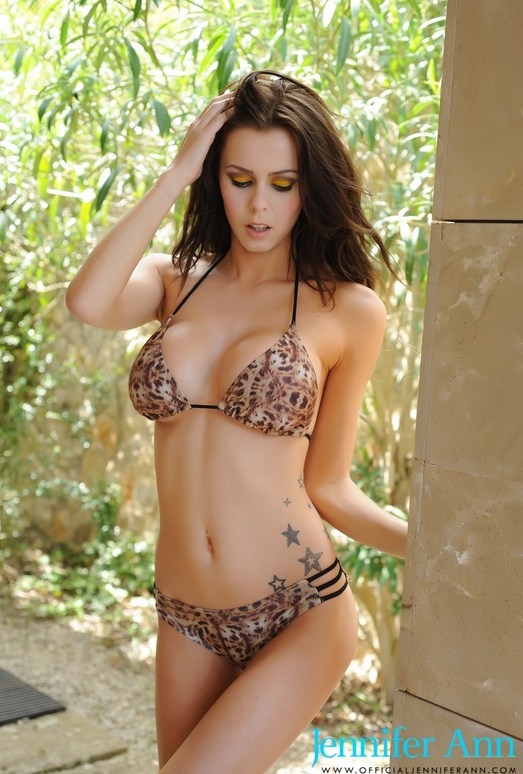 Jennifer Ann teases outdoors in her sexy leopard bra