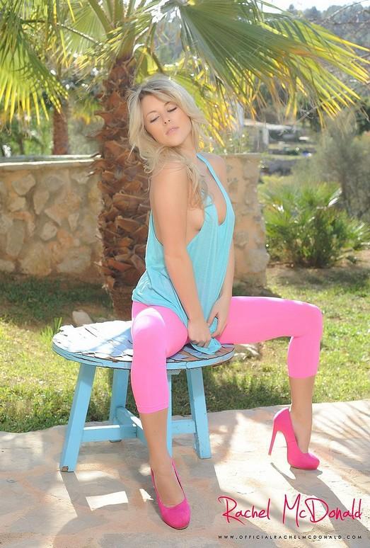 Rachel McDonald strips from her green top