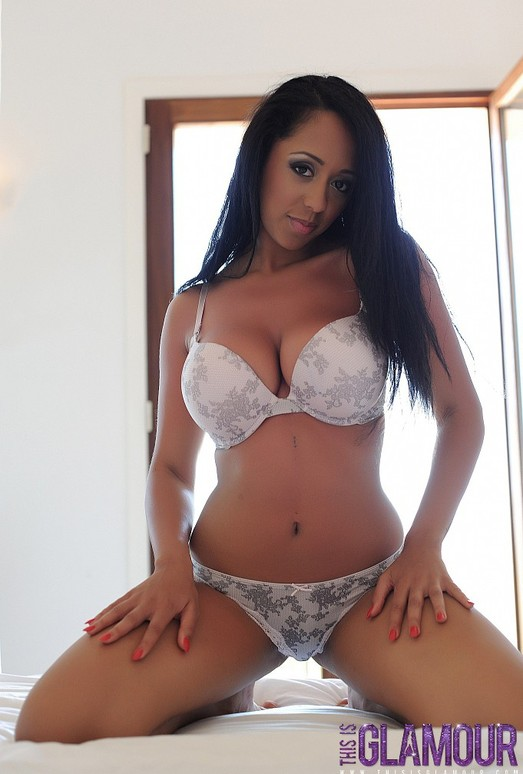 Bobbie teases on the bed in her white lingerie