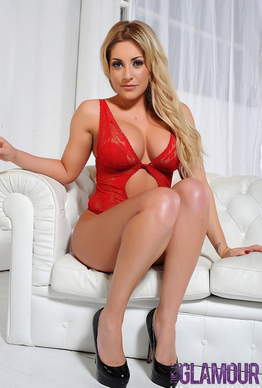 Ashley Emma teases on the white sofa in her red lingerie
