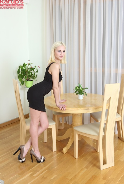 Anna Dambro - blonde slipping out of her black dress