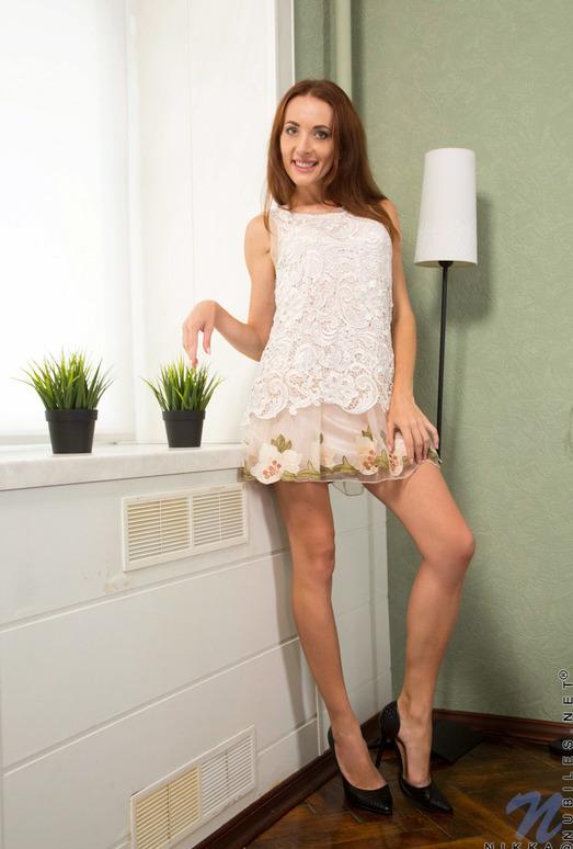 Nikka taking off her floral dress