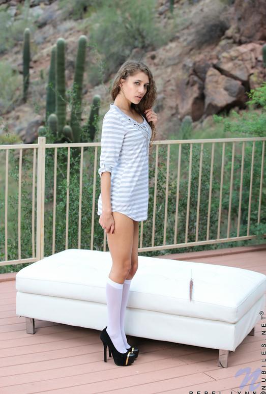 Rebel Lynn - thin teen lounging on the balcony