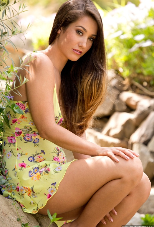 Eva Lovia Goes Topless In A Garden