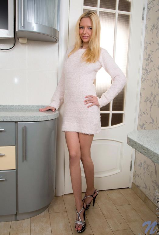 Vicki - thin blonde getting naked