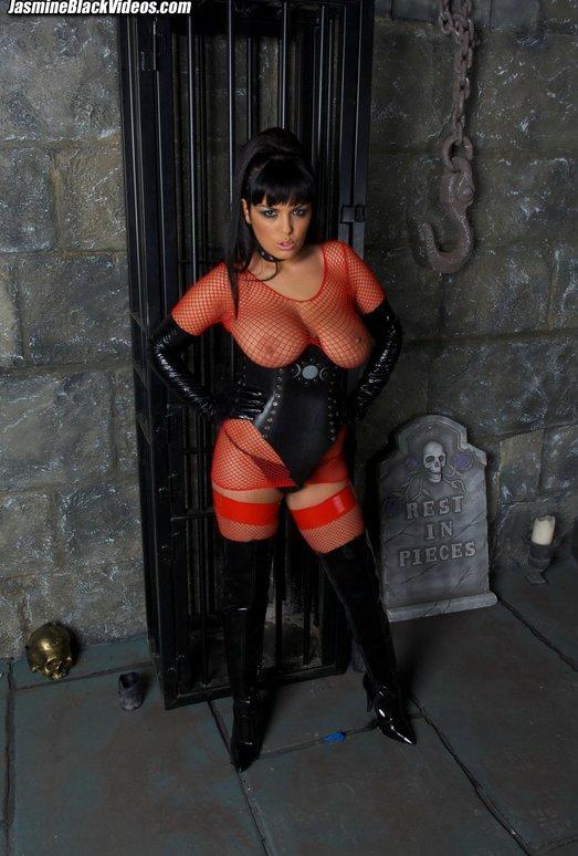 Jasmine Black in a dungeon fucking her sex slave well