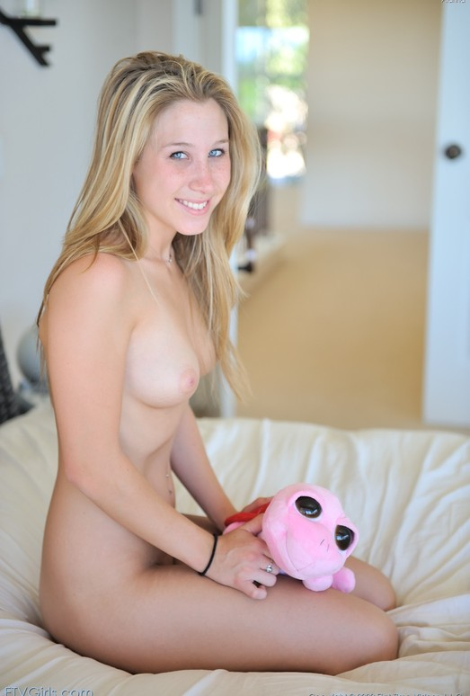 Alanna - spreading her pussy open on the bed