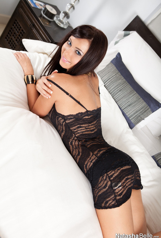 Natasha Belle on her bed in sexy black lingerie