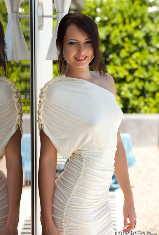 Natasha Belle strips out of her elegant dress while outside