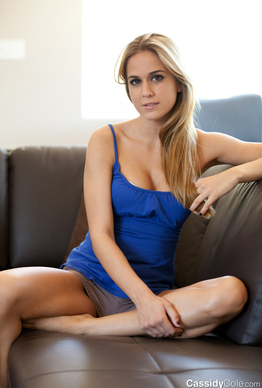 Blonde babe Cassidy Cole strips out of her cutesy blue shirt