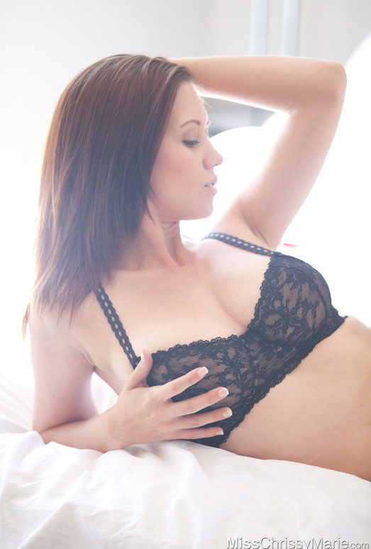 Chrissy Marie gets naked in bed full of rose petals