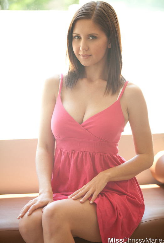 Beautiful Chrissy Marie slips out of her cute pink dress