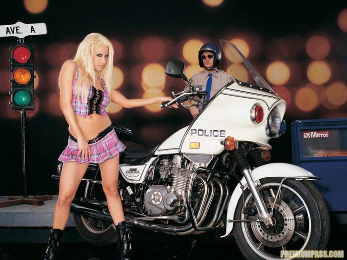 Busty blonde Gina Lynn sucks and fucks a cop