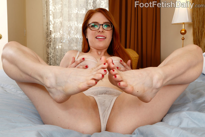 Hot Redhead Wraps Her Sexy Feet Around a Black Cock