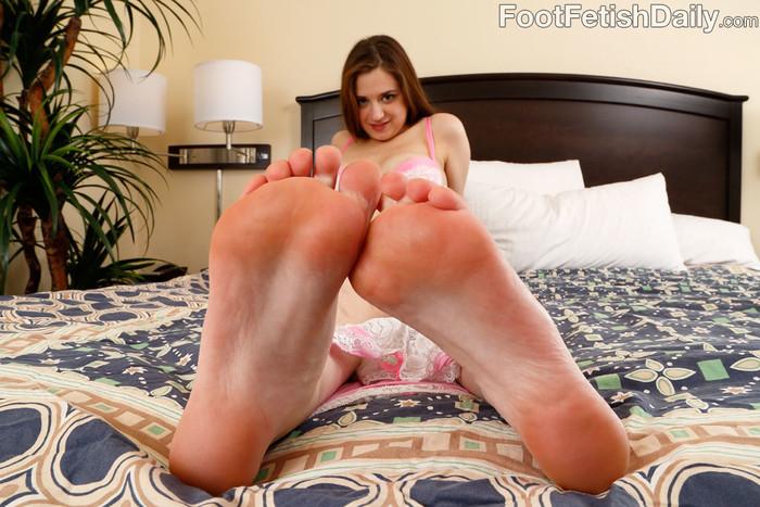 Slutty Brunette Wraps Her Feet Around a Huge Fat Cock