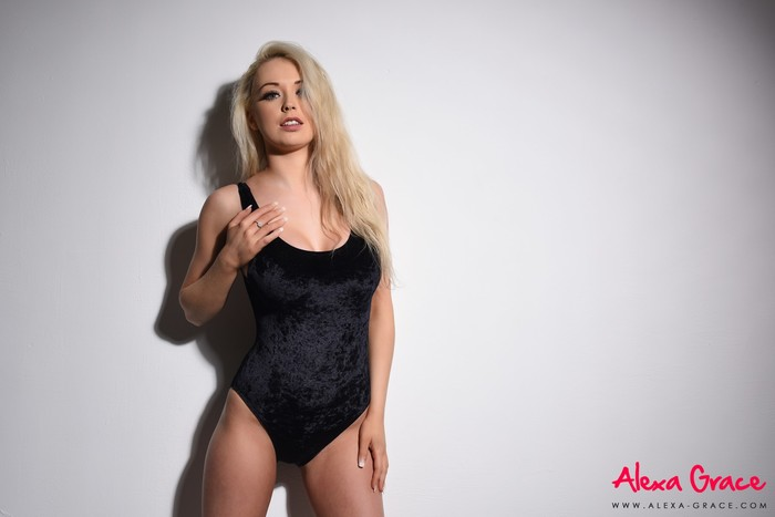 Alexa Grace teasing in her sexy black bodysuit