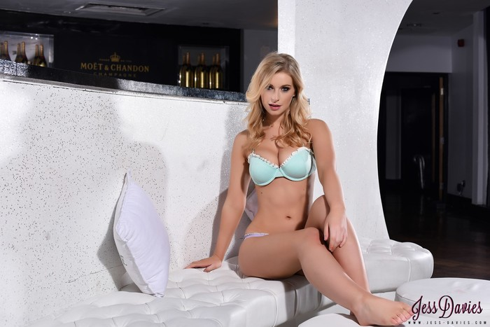 Jess Davies teases on the white sofa, in her lingerie