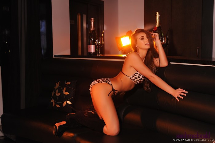 Sarah takes off her animal print lingerie in the lounge