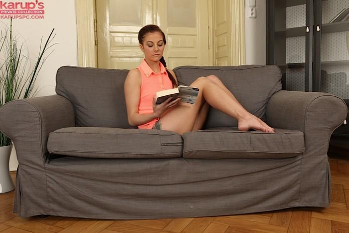 Nikola Bradley reads a book and masturbates