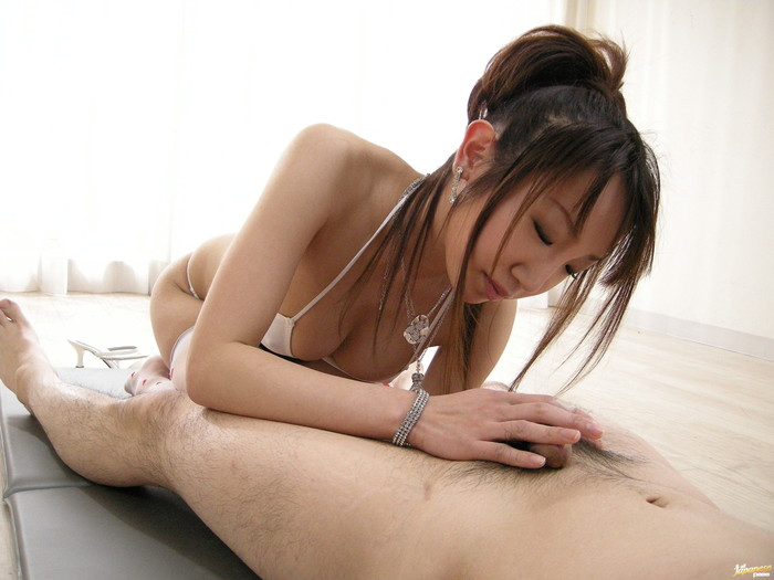 Ai Yumemi Asian model rubs cock on her lovely tits