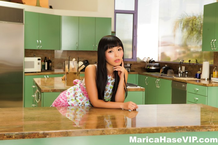 Pretty Marica Hase spreads out on the kitchen counter